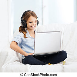 girl with laptop computer and headphones at home - home, ...