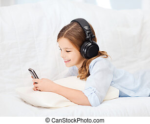 girl with smartphone and headphones at home - home, leisure...