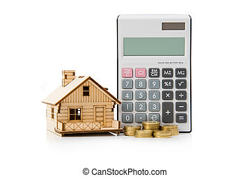 Miniature house model with calculator and gold coins