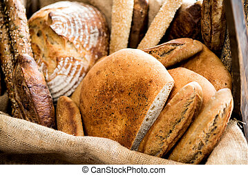 Various kinds of fresh baked bread loaves