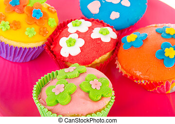 Colorful home made cupcakes with flowers