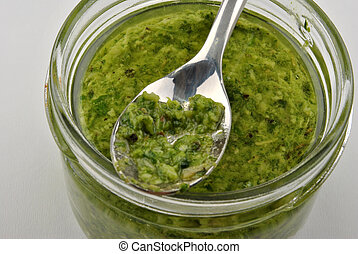 home made fresh pesto in a glass and spoon