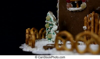 Detail of home made gingerbread christmas trees on black background