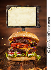 Home made hamburger with blank blackboard - Delicious home...
