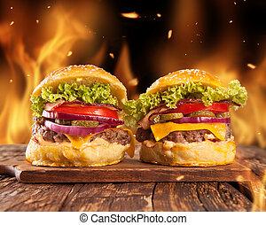 Home-made hamburgers with fire - Fresh home-made hamburgers...