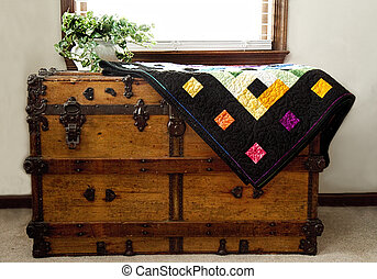 Home-made Quilt on Chest - Home-made quilt on antique wooden...