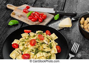 Home made ravioli with basil pesto