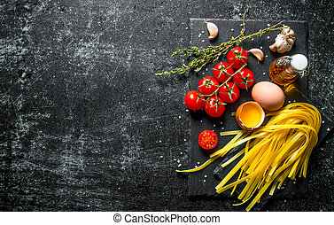 Home made raw pasta with thyme, eggs, oil and tomatoes.