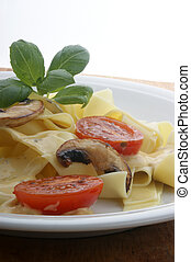 home made tagliatelle with organic tomato and sauce