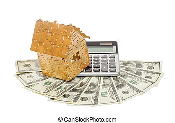 home of gold color on a calculator and dollars
