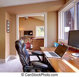 Home office and computer and chair with brown walls. - Home...