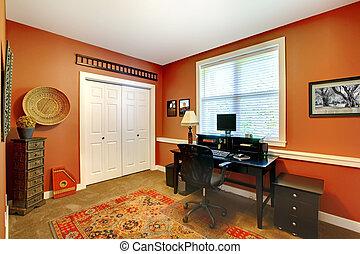 Home office interior design with orange brick walls.