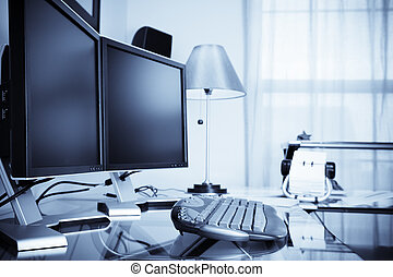 Home office - Modern home office - a desk with dual monitors...
