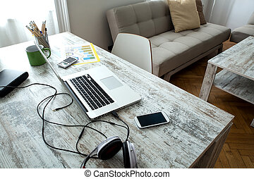 Home office - A modern home office setup on a wooden Table....