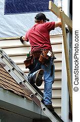 Home Owner Remodeling - Young home owner remodels his older ...