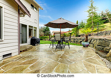 Home patio area overlooking beautiful landscaping - Concrete...