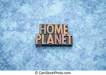 home planet word abstract in wood type