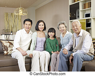 home portrait of a happy asian family