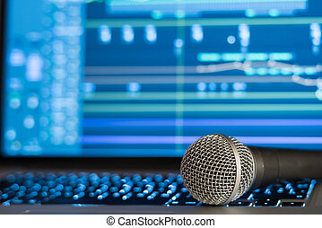 Home Recording Studio - Microphone laying on laptop with ...