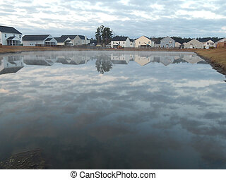 Home Reflections off a pond - This is a photo of homes...