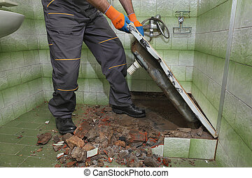 Worker remove, demolish old bathtub and tiles in a bathroom