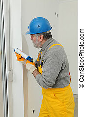 Home renovation, caulking with silicone
