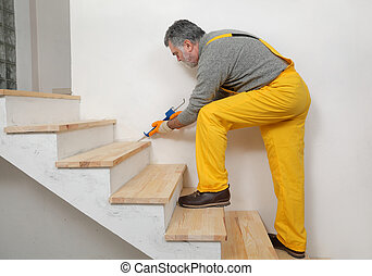 Home renovation, caulking wooden stairs with silicone - ...
