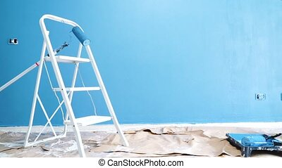 home renovation concept - painted wall with ladder during ...