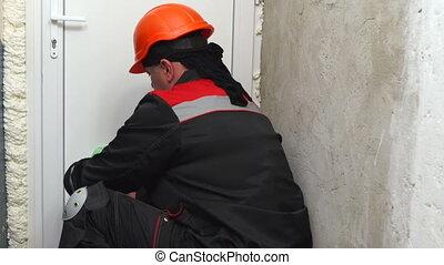 Home renovation construction worker installs new plastic ...