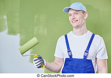 Home renovation man - Young home renovation man in uniform...