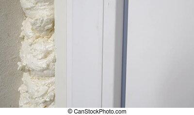Home renovation new plastic white PVC door installation. ...