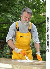 Home renovation, painting wooden door