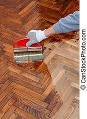 Home renovation parquet - Varnishing of oak parquet floor, ...