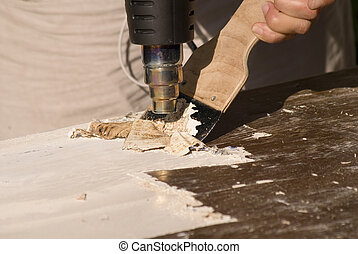 Home Renovation - portrait of renovation; removing old paint...