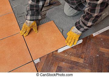 Home renovation, tiles - Home renovation, worker placing...