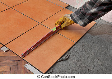 Home renovation, tiles - Home renovation, worker levelling...