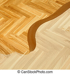 Varnishing of oak parquet floor, first layer of lacquer