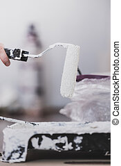 White paint with roller brush
