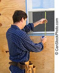 Home Repairs - Man measures window