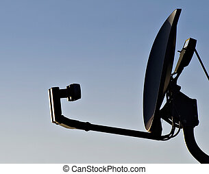 Home Satellite Dish in empty blue sky - Isolated satellite...