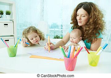 Home schooling - Beautiful mother showing her children how...