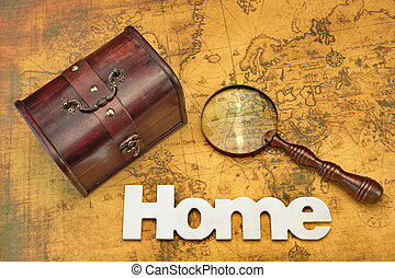 Home Search Or Emigration Concept. Bag Or Storage Box, Wooden Sign Home And Magnifier On the Old Map Background, Top View, Close Up