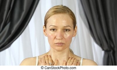 home self-massage, woman doing facial massage after a hard day work