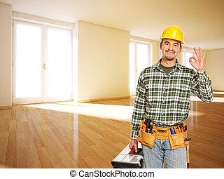 smiling handyman in empty room