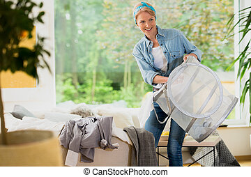 Home service woman doing laundry