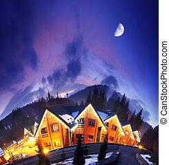 home - Ski resort at the Bukovel. Dramatic sky. Carpathian, ...