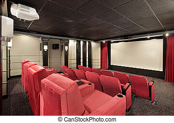 Home theater with red chairs