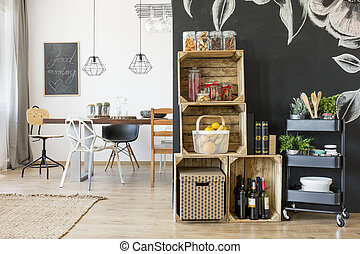 Home with dining area, crate shelves and rolling cart