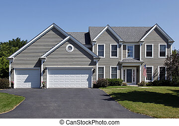Home with gray siding and covered entry - Suburban home with...