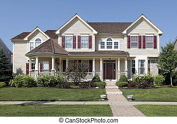 Home with red shutters - Large suburban home with yellow...